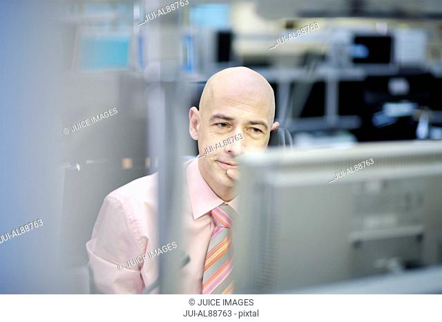 Businessman looking at computer