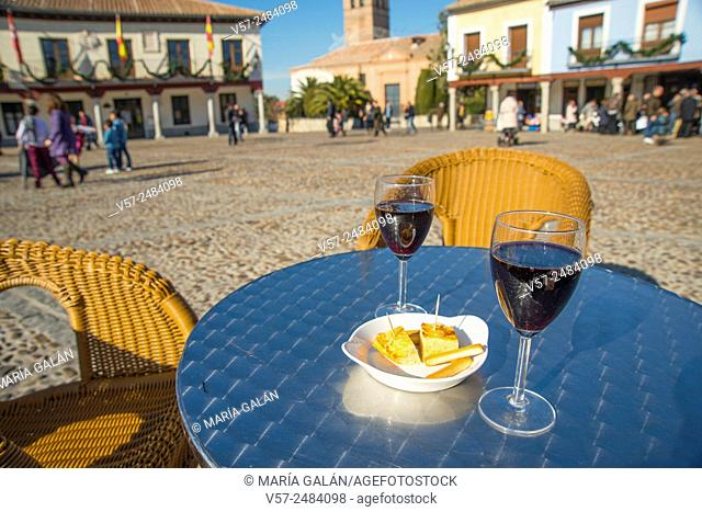 Two glasses of red wine and tapa of Spanish omelette in a terrace. Segovia Square, Navalcarnero, Madrid province, Spain