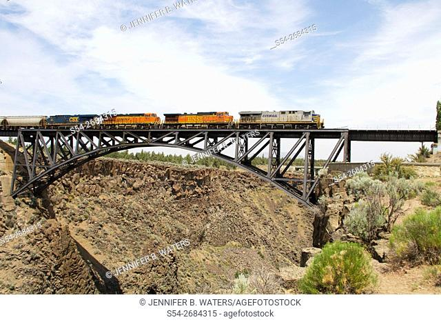 A mixed manifest BNSF train headed by a lease unit crosses the Crooked River Bridge in Peter Skene Ogden State Park near Bend, Oregon, USA