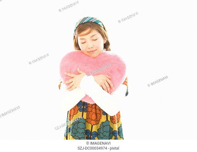 A woman holding cushion