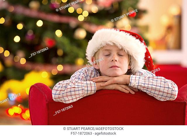 Young boy looking forward for Christmas