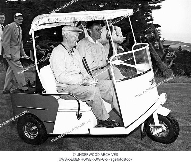Pebble Beach, California: 1956. President Eisenhower riding in a golf cart at Pebble Beach, California