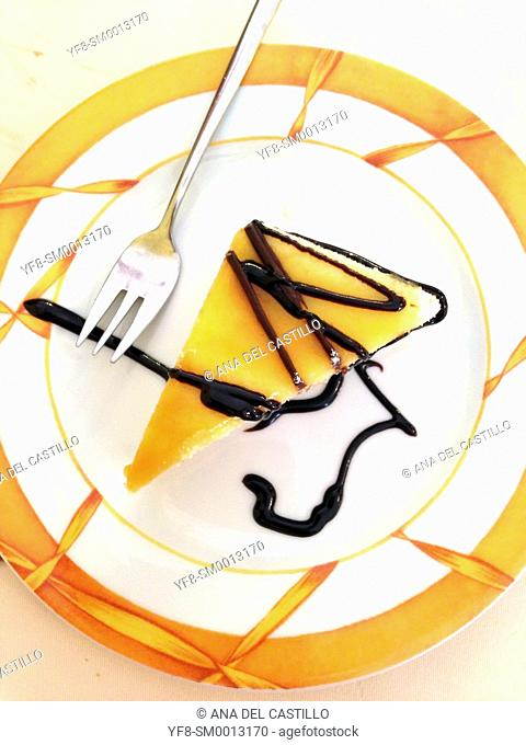 Lemon cheese cake with chocolate sauce served on a white plate