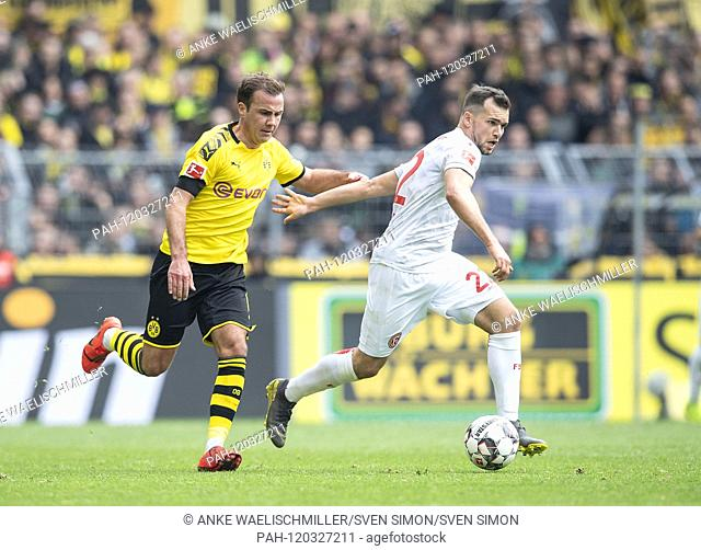 Mario GOETZE (left Gv? Tze, DO) in a duel versus Kevin STOEGER (player, D), action, duels, foul, football 1.bundesliga, 33