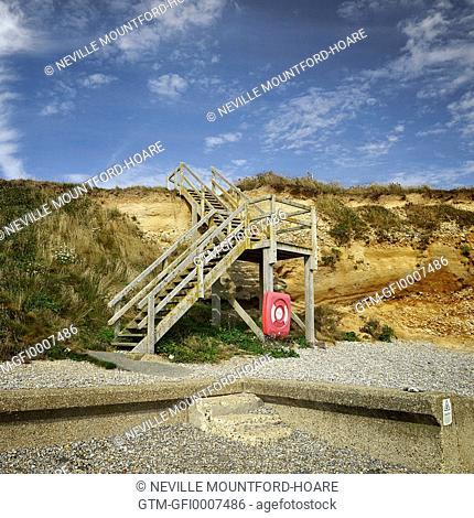 Wooden steps onto pebble beach
