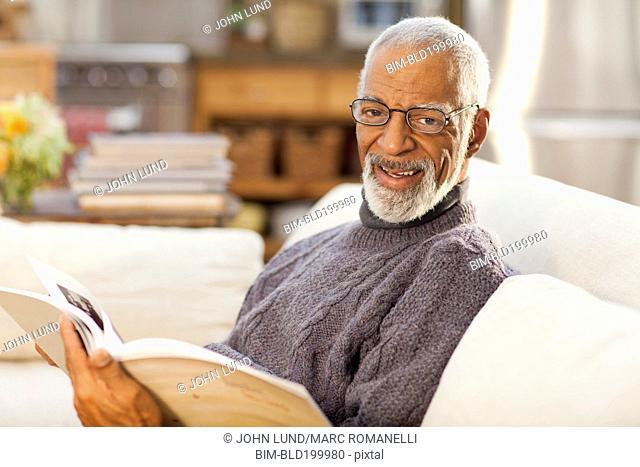 Black man reading book