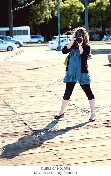 Picture of teenage girl (13-15) taking picture