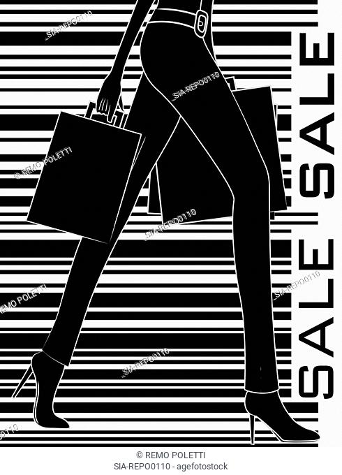 Low section of woman with shopping bags