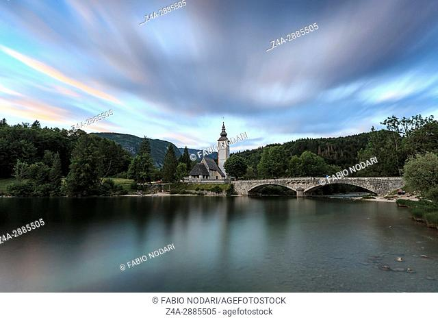 Church of St John the Baptist in Lake Bohinj, a famous destination not far from lake Bled in Slovenia, at sunset