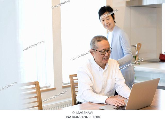 Senior couple enjoying video chatting on laptop