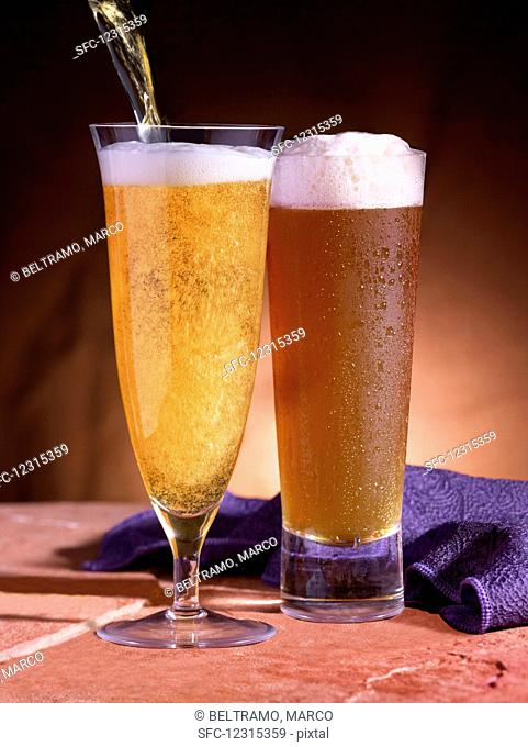 Two different beers in glasses