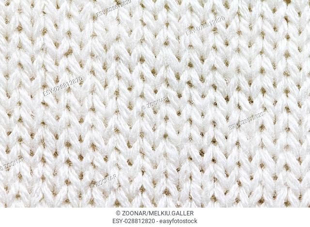 Knitted background of white color