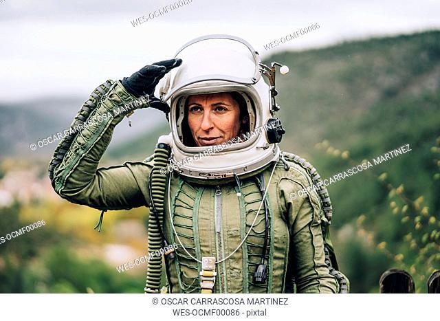 Portrait of woman in space suit exploring nature