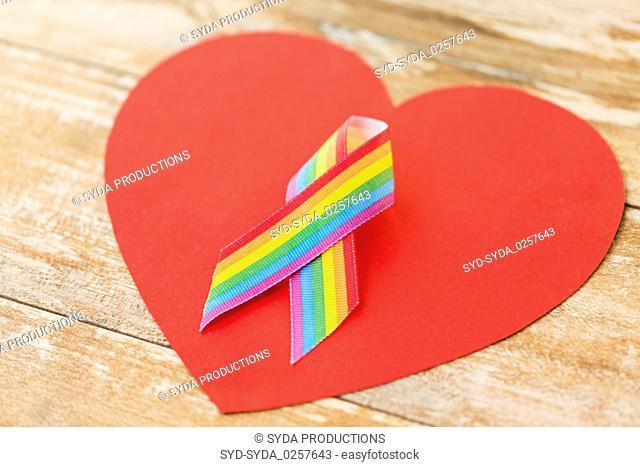 close up of gay pride awareness ribbon on heart