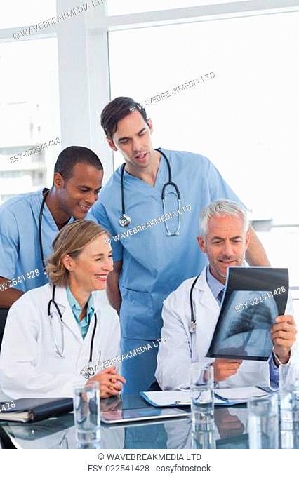 Medical team examining radiography