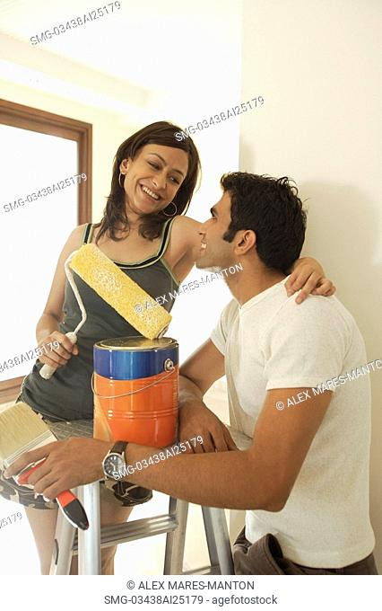 Indian man painting house Stock Photos and Images | age fotostock