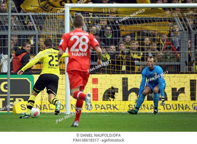 Dortmund's Julian Schieber scores the 1-0 goal against Augsburg's Alex Manninger goalkeeper during the Bundesliga soccer match between Borussia Dortmund and FC...