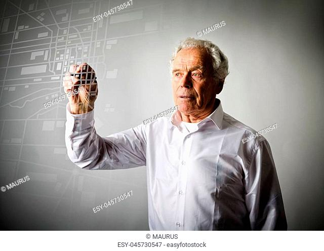 Old man is looking for a route on the city map. Amnesia concept