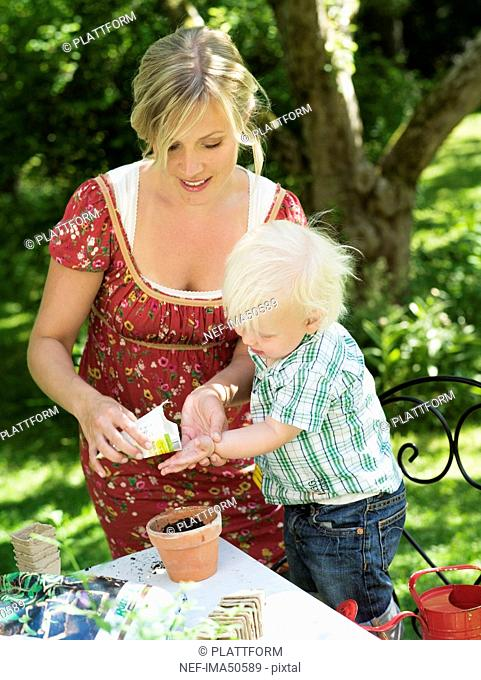 Mother and son planting seed, Stockholm, Sweden