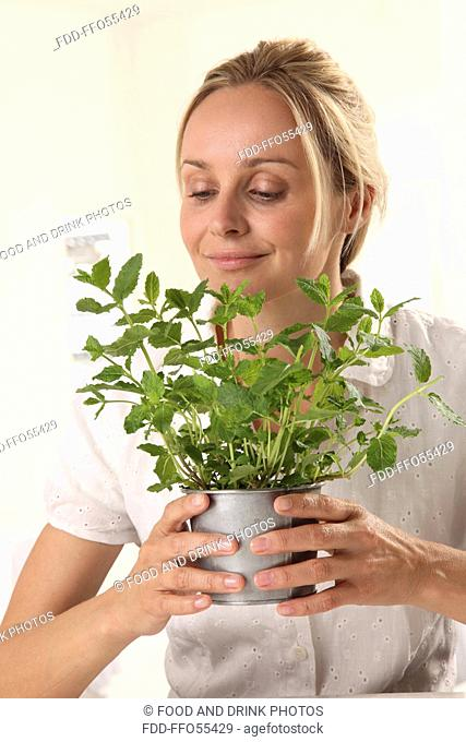 Woman With Mint Plant