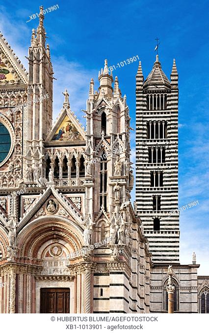 Portal and bell tower at the gothic cathedral, Cattedrale di Santa Maria Assunta, square Piazza Duomo Siena,Tuscany, Central Italy