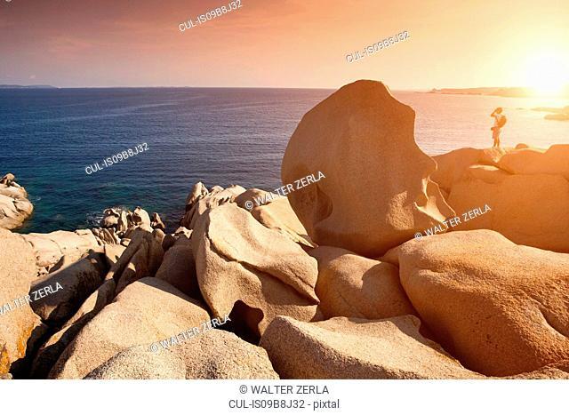 Man at cliff top, Capo Testa, Sardinia, Italy