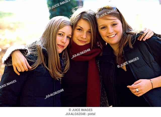 Portrait of three female friends outdoors in Autumn