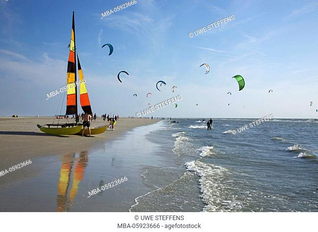 Kitesurfer and catamaran on the Sand bank in front of Saint Peter-Ording