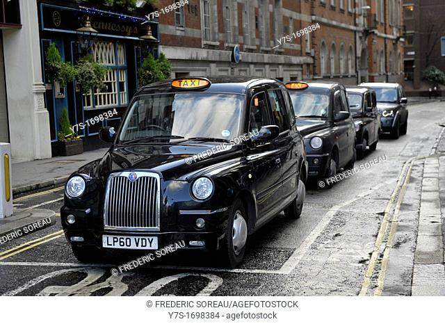 Black cabs,the typical london black taxi car in London,England,United Kingdom