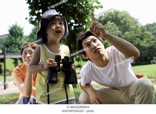 A boy holding binoculars