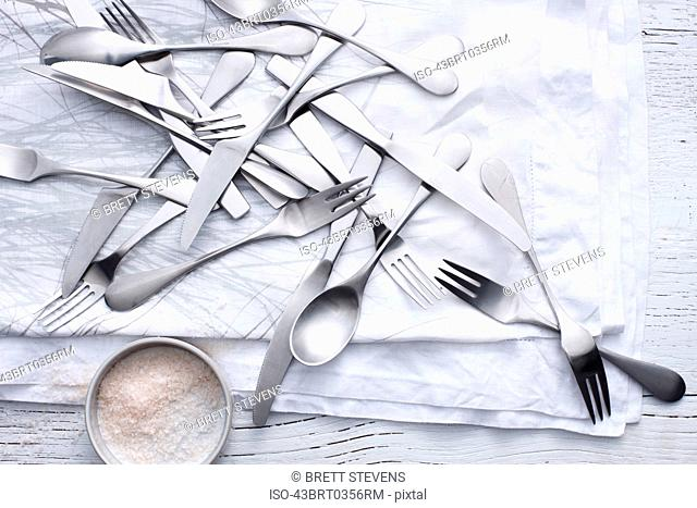 Silverware and flour on table