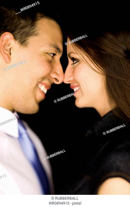 Side profile of a young couple standing face to face
