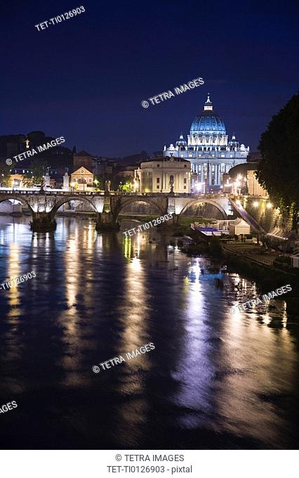 The Tiber River with St. Peter's Basilica at night, Italy