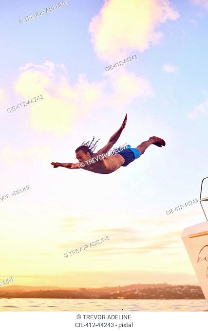 Young man diving into ocean