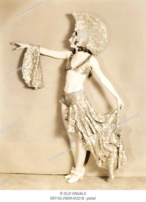 Side view of dancer posing in sparkly costume