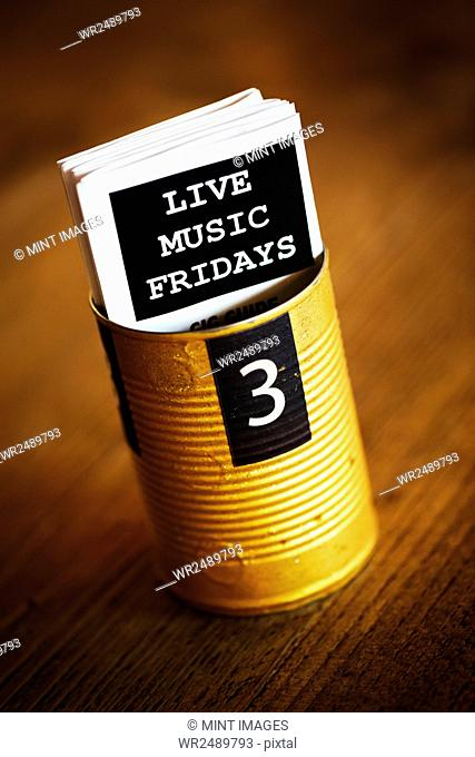 Specialist coffee shop. A tin with the number 3, and flyers advertising live music