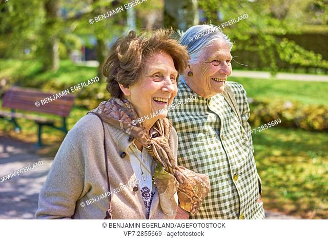 Happy old senior women together in park