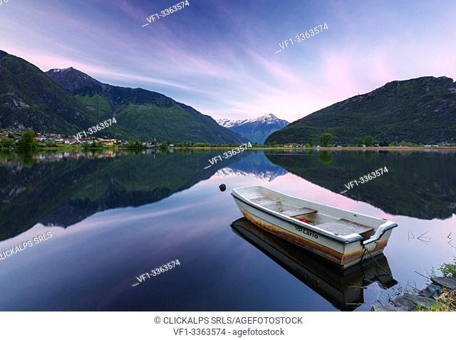 Boat moored in lake of Novate Mezzola at sunrise, Valchiavenna, Sondrio province, Valtellina, Lombardy, Italy