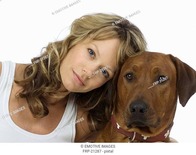 Woman leaning against dog