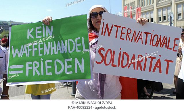 People demonstrate with banners and posters and show their solidarity with protests against the government in Turkey in Hamburg, Germany, 08 June 2013