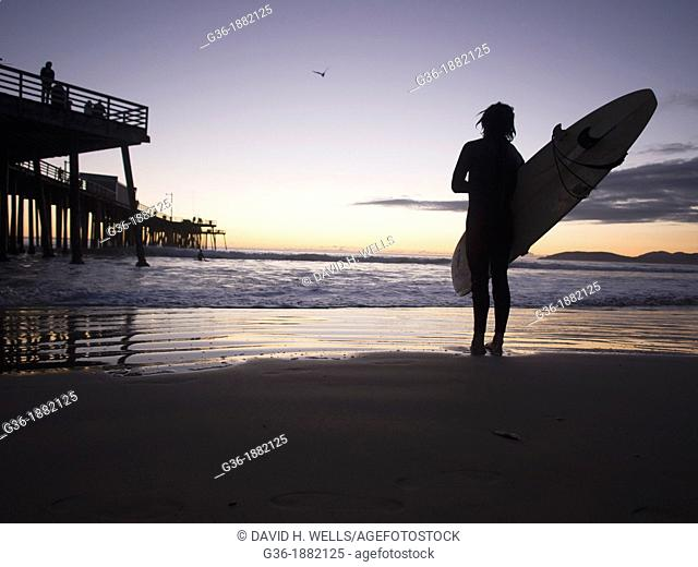 Surfer on the beach in pismo Beach, California