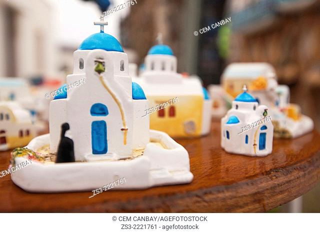 Souvenir blue domed church figurines on the bench for sell, Pyrgos, Santorini, Cyclades Islands, Greek Islands, Greece, Europe