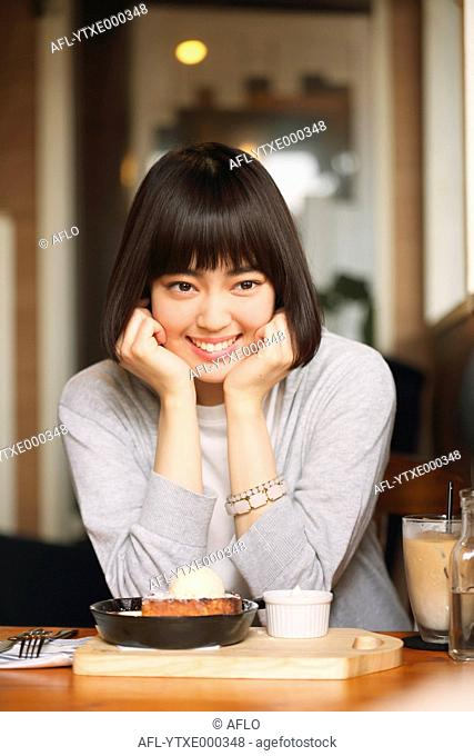 Young Japanese woman at a cafe downtown Tokyo