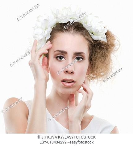 Beautiful tender woman wearing headpiece and white dress