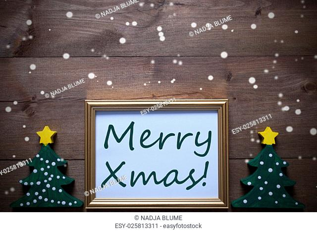 One Golden Picture Frame With Two Green Christmas Tree. English Text Merry Xmas. Christmas Card For Seasons Greetings. Christmas Decoration With Brown Wooden...