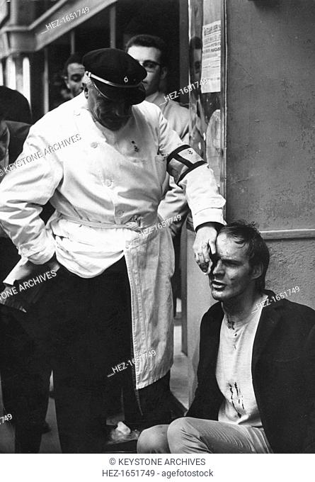 Man injured in a riot, Latin Quarter, Paris, May 1968. Widespread protests and riots by students opposed to the policies of the government of President De...