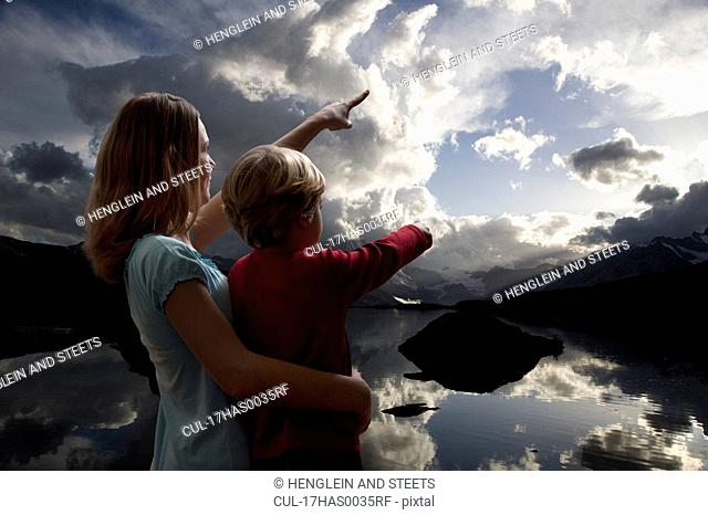 boy and girl watching the sky