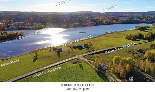 Lake Gensjosjön near Bredbyn in northen Sweden seen from the air on a sunny autumn day
