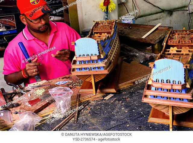 man working in factory of handmade scale model wooden ships in Curepipe, Mauritius, Africa