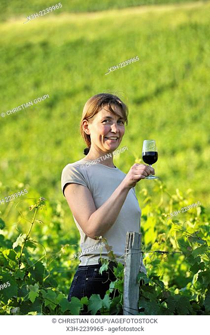 Veronique Dupasquier, wine grower, tasting wine in the vineyard at Jongieux, Savoie department, Rhone-Alpes region, France, Europe